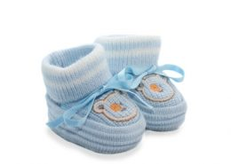 Bootees for the baby, blue, on a white background, it is isolated.